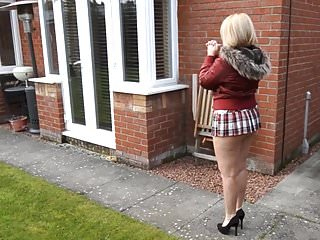 Mature neighbor walks with short skirt and bare ass outdoors