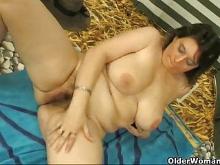 Chubby milf with big tits masturbates with cucumber
