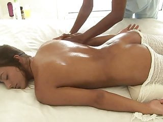 Slender sexy brunette relaxes at massage and gets pussy fing