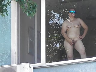 Hairy mature flashing in window