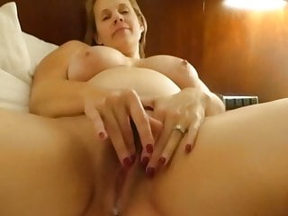 Busty Jenny playing with her wet pussy