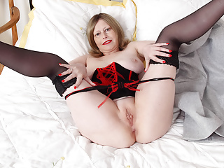 British milf Posh Sophia shows off her natural big hangers