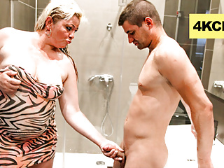Wet Mature Blonde Messing Up a Twink's Cock