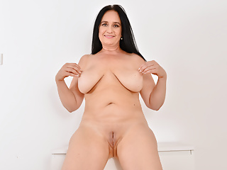 Euro milf Ria Black strips off and fingers her wet cunt