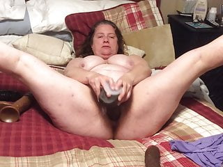 BBW mom with hairy pussy fucks her black dildos