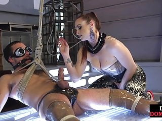 BDSM dominatrix teases sub with bj and whipping